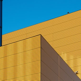 Yellow building against blue sky